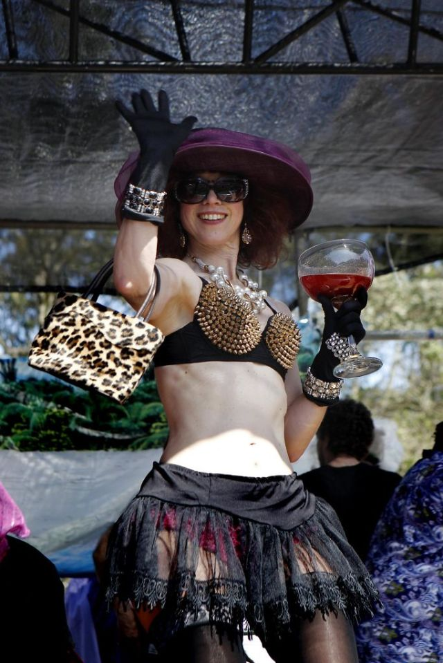 """Foxy Mary Competition contestant """"Bloody Mary"""" waves from on stage at the 37th annual Easter in the Park celebration put on by the Sisters of Perpetual Indulgence in San Francisco, Calif., on Sunday March 27, 2016. Photo: Brittany Murphy, The Chronicle"""