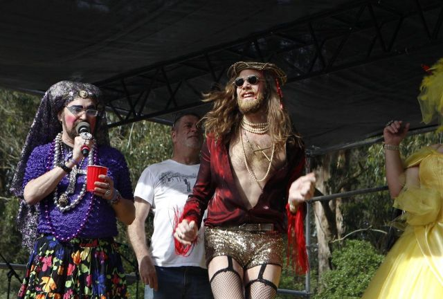 """Sister Dana Van Iquity, left, introduces Hunky Jesus contestant """"Drop Dead Jesus"""" during the 37th annual Easter in the Park celebration put on by the Sisters of Perpetual Indulgence in San Francisco, Calif., on Sunday March 27, 2016. Photo: Brittany Murphy, The Chronicle"""