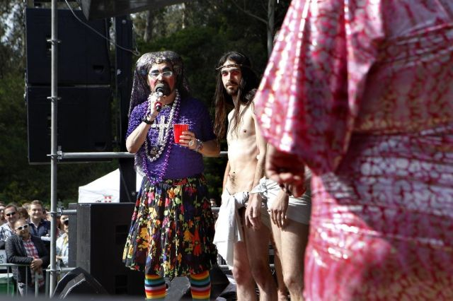 Sister Dana Van Equity, left, introduces several of the contestants in the Hunky Jesus Competition held during the 37th annual Easter in the Park celebration put on by the Sisters of Perpetual Indulgence in San Francisco, Calif., on Sunday March 27, 2016. Photo: Brittany Murphy, The Chronicle