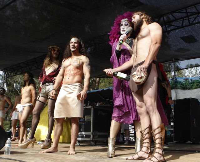 Sister Roma, center, introduces several of the contestants in the Hunky Jesus Competition held during the 37th annual Easter in the Park celebration put on by the Sisters of Perpetual Indulgence in San Francisco, Calif., on Sunday March 27, 2016. Photo: Brittany Murphy, The Chronicle