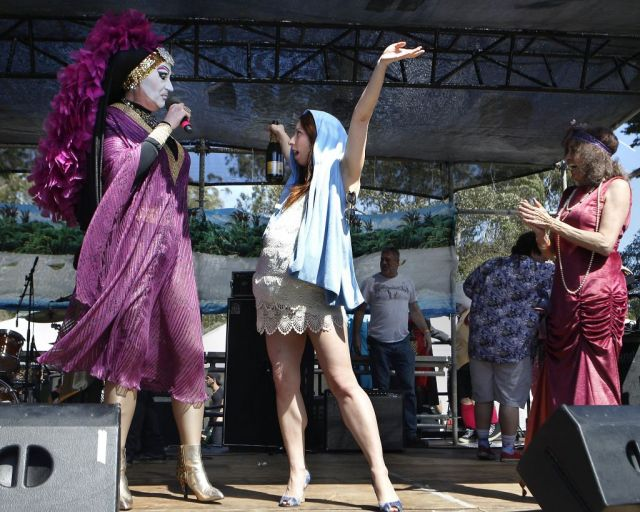 "Sister Roma, left, introduces ""Pregnant Reality TV Mary"", one of the contestants in the Foxy Mary Competition held during the 37th annual Easter in the Park celebration put on by the Sisters of Perpetual Indulgence in San Francisco, Calif., on Sunday March 27, 2016. Photo: Brittany Murphy, The Chronicle"