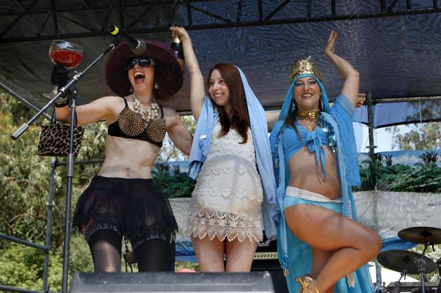 "This years Foxy Mary contestants, ""Bloody Mary"", left, ""Pregnant Reality TV Mary"" and ""Bollywood Mary"" pose on stage during the 37th annual Easter in the Park celebration put on by the Sisters of Perpetual Indulgence in San Francisco, Calif., on Sunday March 27, 2016. Photo: Brittany Murphy, The Chronicle"