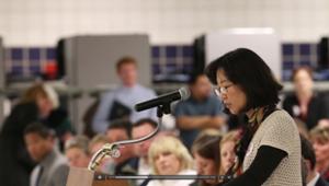 Mom-speaking-school board
